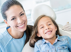 dentist and kid in dental chair smiling
